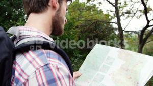 Close up of hiker looking a map