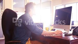 Male graphic designer working on computer monitor
