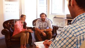 Couple having discussion with therapist