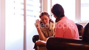 Female patient having discussion with therapist
