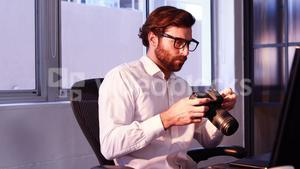 Male graphic designer working in office