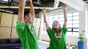 Excited volunteers wearing green ecologic t-shirt
