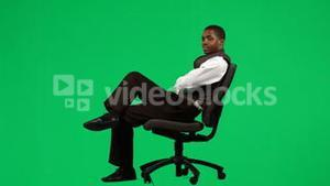 AfroAmerican businessman relaxing on a chair footage