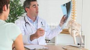 Doctor explaining an injury to a patient