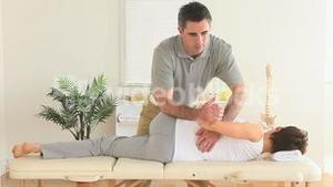 Chiropractor stretching a womans back