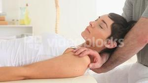 Chiropractor stretching the neck of a woman