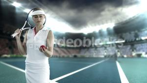 Tennis player throwing and catching ball