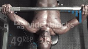 Bodybuilder lifting heavy barbell weights against animated background