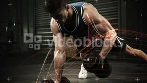 Athlete performing push ups with dumbbell against the animated background