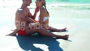 Couple romancing at beach