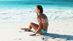 Beautiful woman sitting on beach