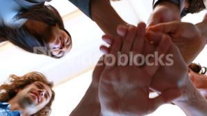 Businesspeople forming hands stack