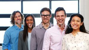 Portrait of businesspeople standing and smiling