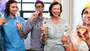 Businesspeople toasting glasses of wine