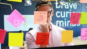 Businessman looking at the sticky notes