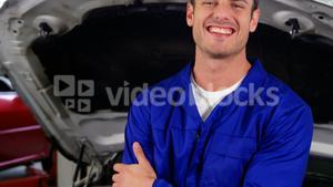 Mechanic standing in repair shop with wrench