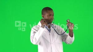 Footage of an AfroAmerican male doctor using his stethoscope
