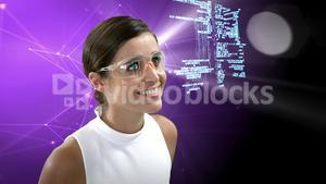 Businesswoman looking at digitally generated text and graphic
