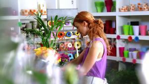 Female florist working in flower shop