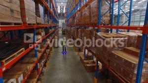 Warehouse worker on hoverboard at warehouse