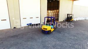 Warehouse worker driving forklift