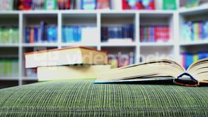 An open book on sofa in library at school