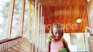 Schoolgirl walking on staircase at school