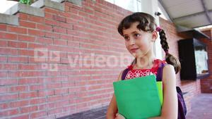 Schoolgirl walking in corridor at school