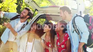 Group of friends taking a selfie from trunk of car