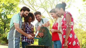Man serving barbecue to his friends