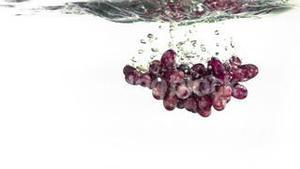 Grapes splashing into water in super slow motion