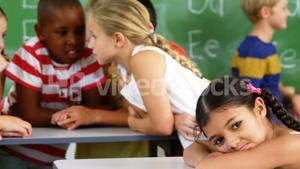 School kids interacting with each other in classroom