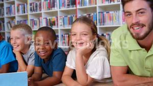 School kids with teacher in library