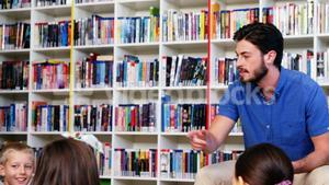 Teacher interacting with students in library