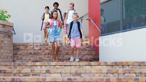 School kids walking on staircase