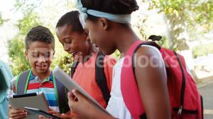 Group of school kids using digital tablet