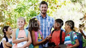 Teacher standing with school kids