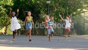 School kids running in school campus