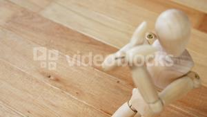 Figurine kneeling in front of broken heart