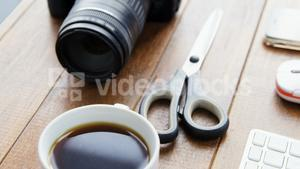 Camera and black coffee on a table