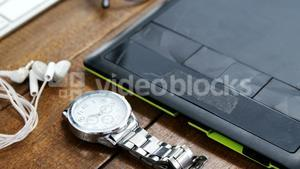 Graphics tablet and wristwatch on a table