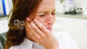 Unhappy female patient having a toothache