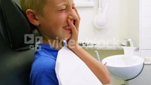 Unhappy young patient having a toothache