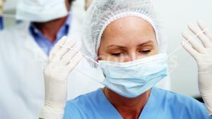 Dentist and dental assistant wearing surgical mask