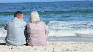 Mature and young couple at beach