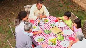 Family eating outdoors together