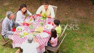 Family dining outdoors together