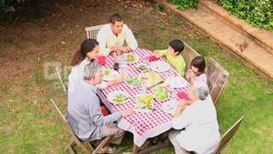 Family having dinner outdoors