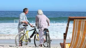 Couple with bikes together at beach