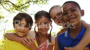 Group of kids standing together with arms around